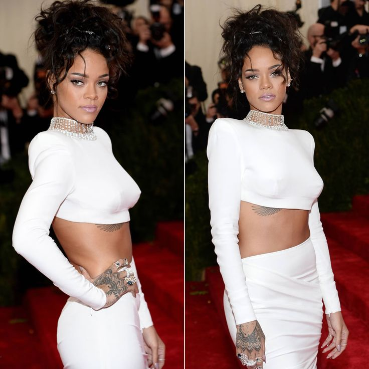 Rihanna at the 2014 Costume Institue Met Gala in white Stella McCartney cropped top and skirt.