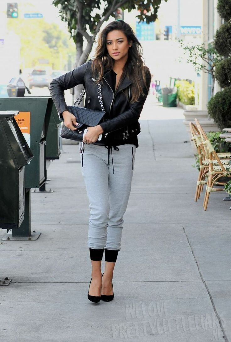 Dress in a black leather biker jacket and grey jogging pants for a casual get-up. For footwear go down the classic route with black suede pumps.  Shop this look for $77:  http://lookastic.com/women/looks/black-biker-jacket-black-crossbody-bag-grey-sweatpants-black-pumps/5547  — Black Leather Biker Jacket  — Black Quilted Leather Crossbody Bag  — Grey Sweatpants  — Black Suede Pumps