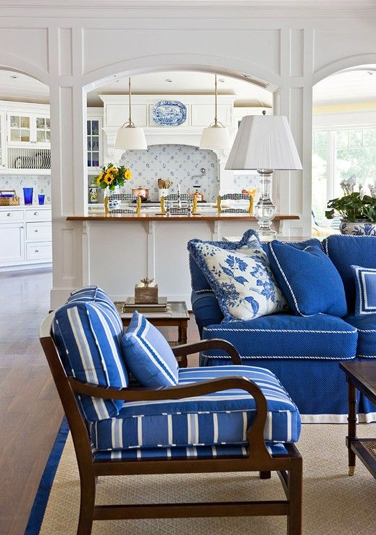 Splashy Living Room Pretty cobalt, royal, and French blues drench furniture, fabrics, and walls in this updated suite of rooms near the river. The only color addition is in the French Country kitchen, where spirited yellow accents add a feeling of sunshine. A blue-and-white tile backsplash eases the transition between kitchen and living room, where crystal lamps illuminate the same palette.