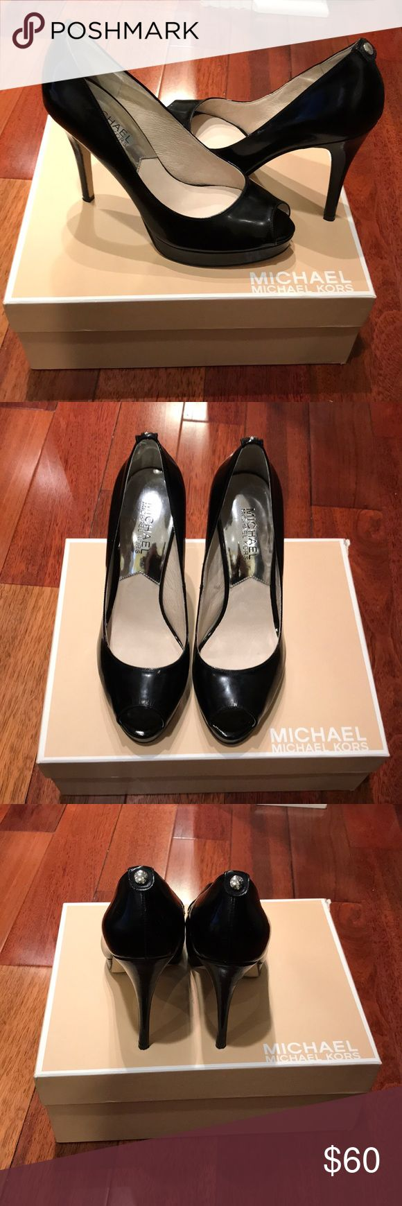 """Michael Kors York Platform Patent Leather Peep Toe Only worn once A patent leather shiny black peep toe pump from Michael Michael Kors. Platform is just right and heel height is sleek and sexy for that polished finish for white pants, denim or cocktail dress. Patent leather upper,Leather lining, Logo button at heel Rubber sole, 4 1/2"""" heel height, 1"""" front platform Michael Kors Shoes Heels"""