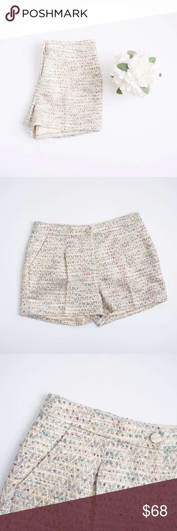 Ted Baker Metallic Tweed Shorts Ted Baker metallic tweed shorts size 3. Please look at measurements. Inseam 3 inches, waist 16 inches, rise 11.5 inches. Polyester, viscose, acrylic, cotton and other fibers. Chino work short style. No stains or holes, excellent condition. Ted Baker Shorts