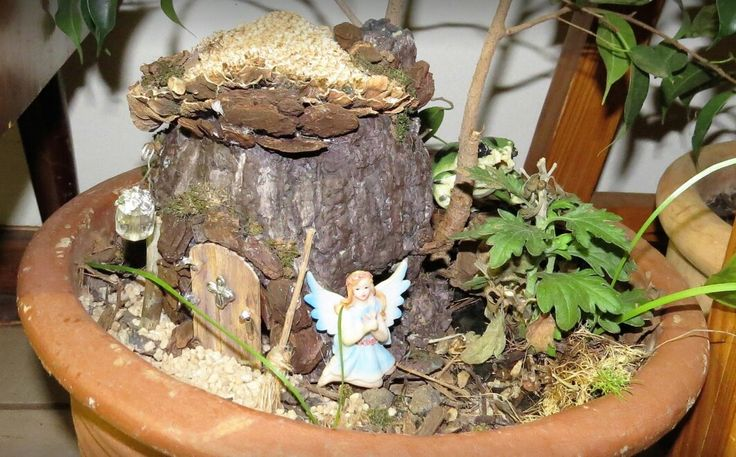 Fake tree stump fairy house