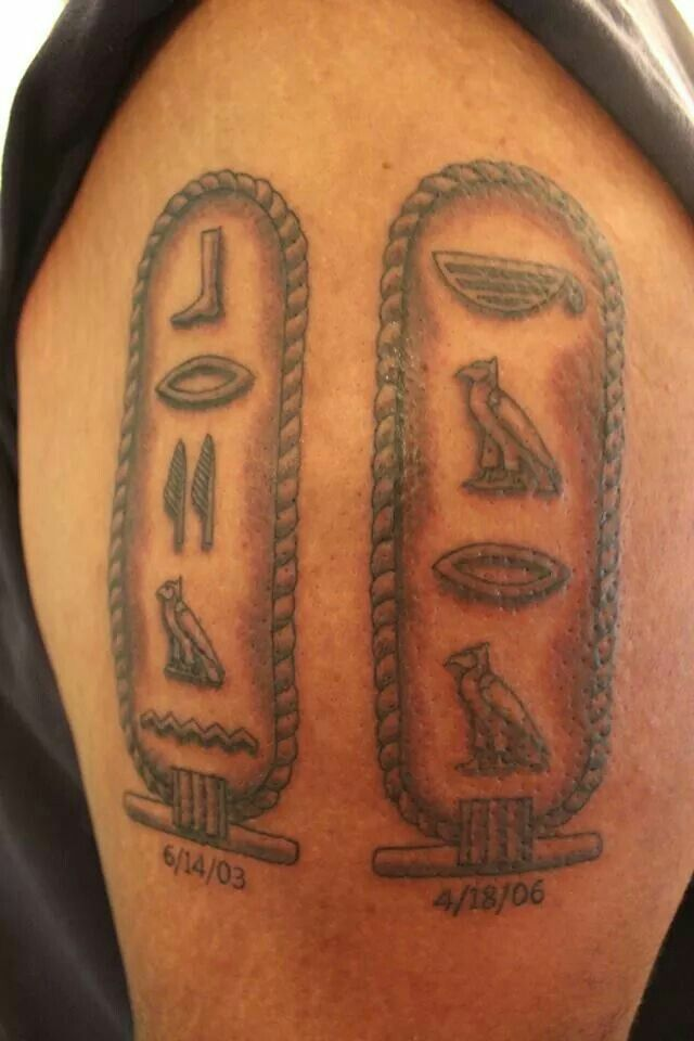 Awesome tattoo - Kids' names in Egyptian hieroglyphics, encased in cartouches, with birthdates underneath. Tattoo done by Dominick Manco at http://newrepublictattoo.com
