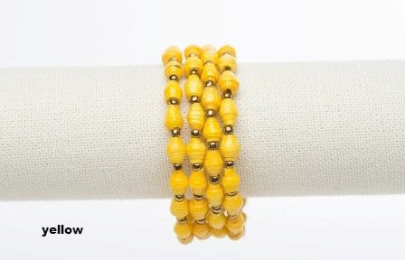 Ssanyu bracelet - yellow.  This wrap around bracelet was named Ssanyu,by the women, meaning Joy. It is also a name given to women. Hand rolled paper beads strung on metal cording, wrap happily around your wrist two or three times. No need for a fastener.