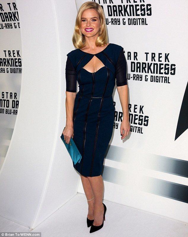 Fashion frontier: Alice Eve looked almost from another galaxy in her rubber lined outfit that showed off her cleavage