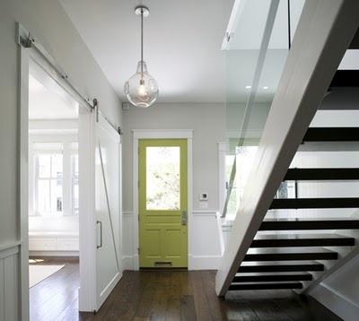 Bright door, wood floor, barn doors, open stair.