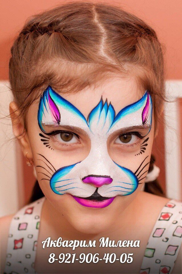 Bold kitty that doesn't cover eyes. Face painting.