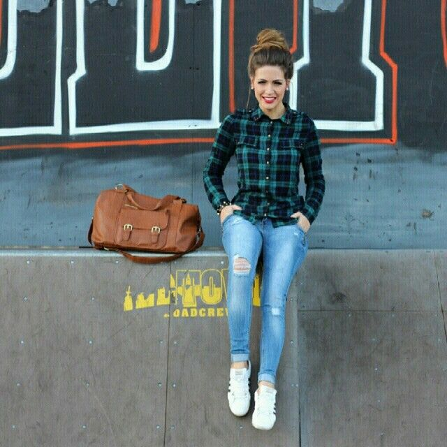 Plaid shirt, tattered jeans and white sneakers