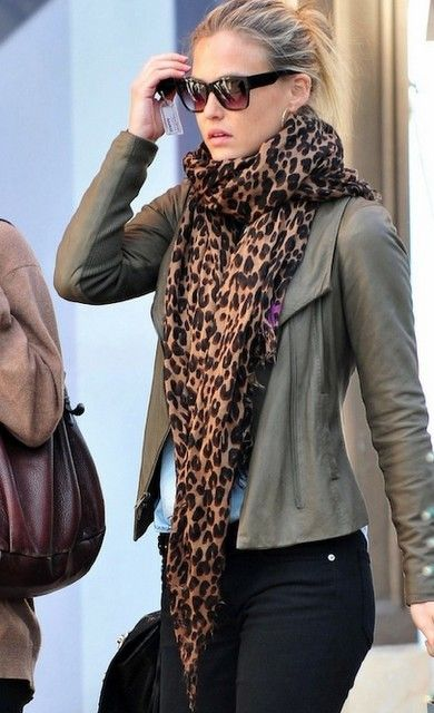 Olive green jacket, jeans and leopard print scarf.