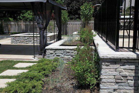 Unilock - Rivercrest wall and Umbriano paver in Ontario
