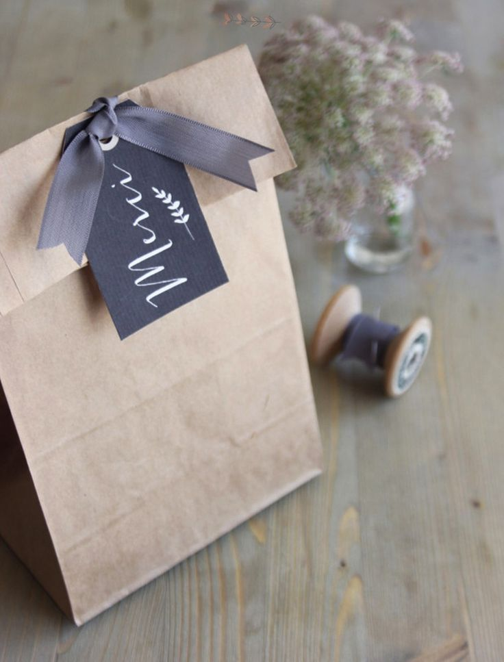 Simple chalkboard tag & a pretty ribbon to close a paper bag favor or gift