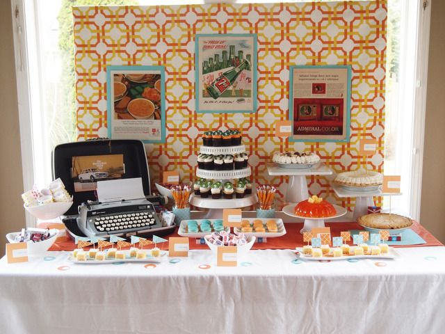 Retrotastic-inspired party with typewriter and treats, vintage suitcases, period advertising, and candy Mad Men colors.