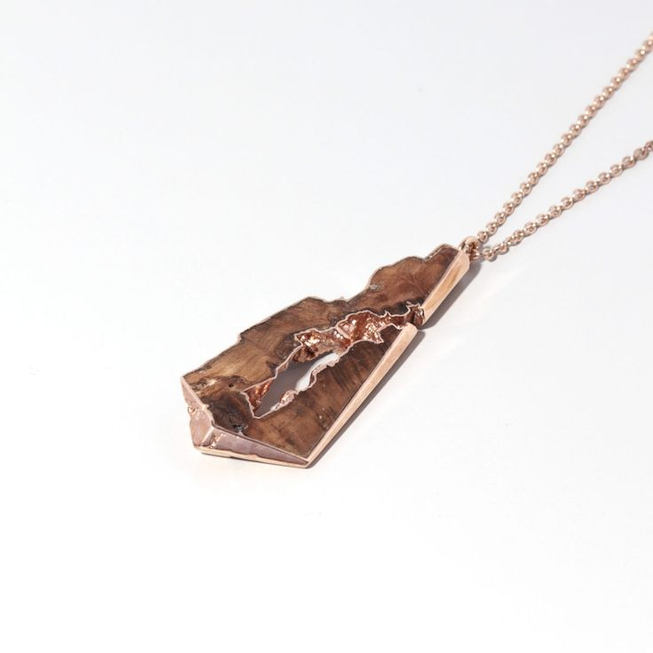 Cherry wood and 22ct rose gold  pendant. Perfect for a 5th year anniversary gift.