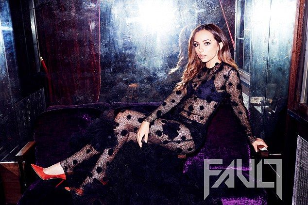 At ease: Jade Thirlwall posed casually in an ensemble comprising of a sheer black poker do...
