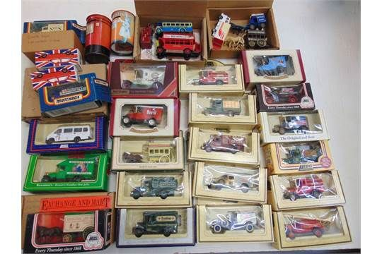Collection of Lledo boxed replica vintage commercial vehicles, two tin money boxes, etc