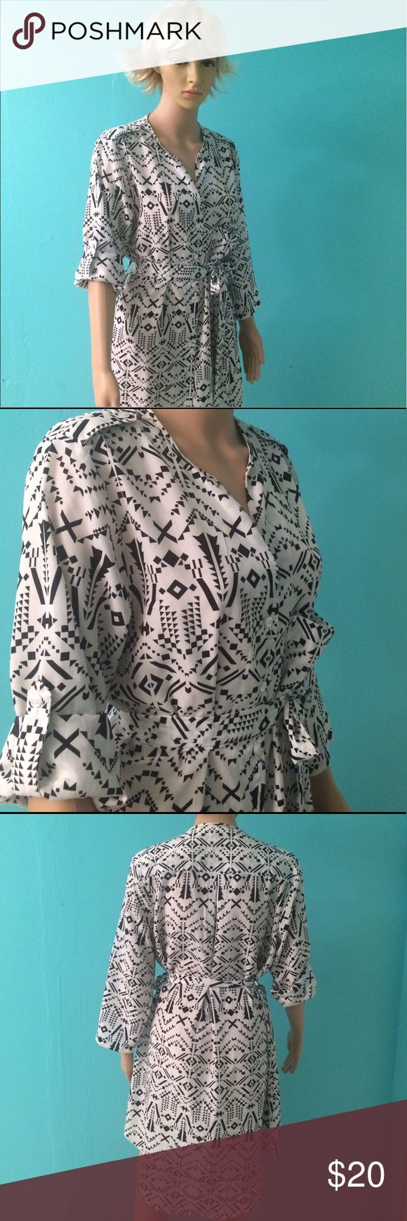 Black and White Shirt Dress. Nice patterned shirt dress that can be worn with long sleeves or short sleeves. Its very comfortable and great for any event. It can also be worn over a black dress. It comes with a cloth belt. It is shorter in the front than the back.      shirt dress, dress, white dress, black dress fate Dresses High Low