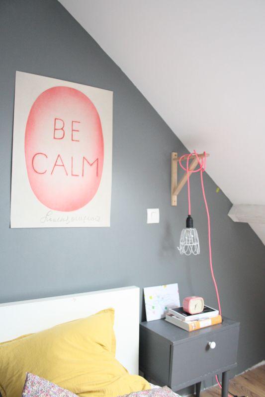 Use an IKEA ledge to hang a bedside light.