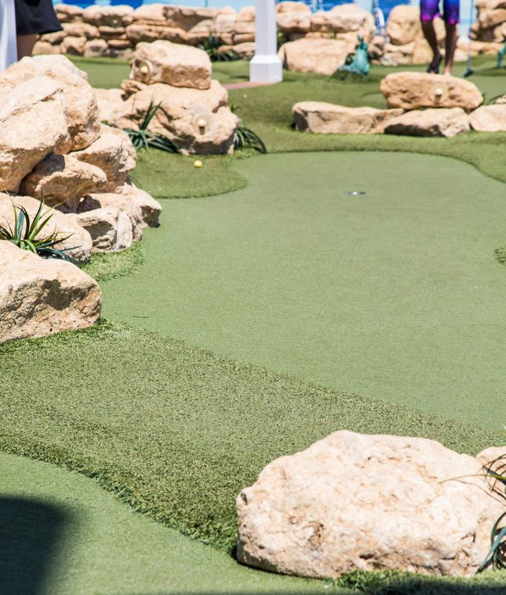 Fake grass on a miniature golf course on a luxury cruise ship