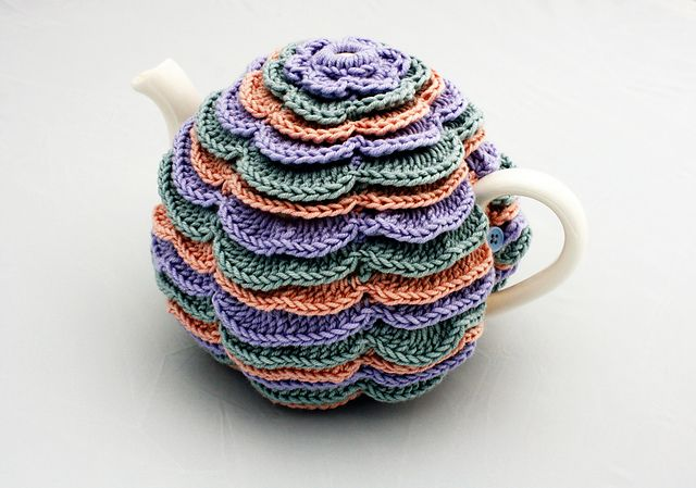 Ravelry: Sweet Flowers Tea Cosy pattern by Catherine Hirst. Paid pattern