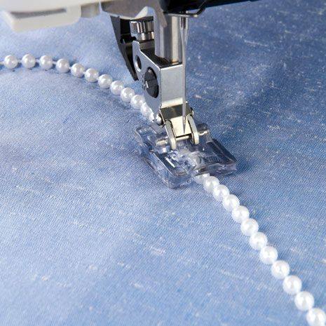 Pfaff - 2-3 mm Beading Foot. For that extra touch, highlight any sewing project with strings of pearls or beads. The beads will run smoothly through the groove under the foot while you sew for beautiful results.