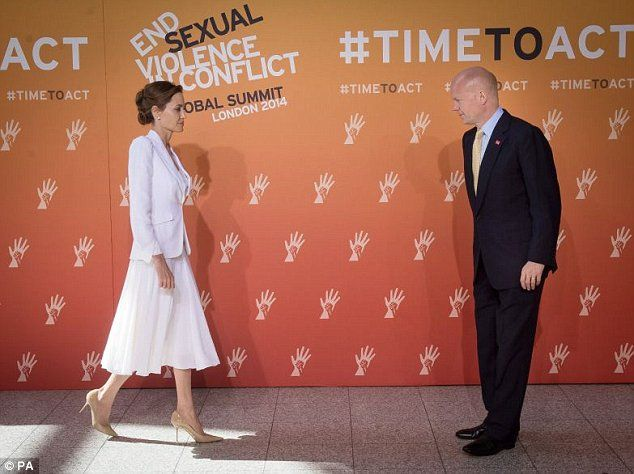 The Foreign Secretary William Hague (right) has hailed the 'enormous transformative' influence of Angelina Jolie in the campaign to end the 'mass crime' of sexual violence in conflict zones
