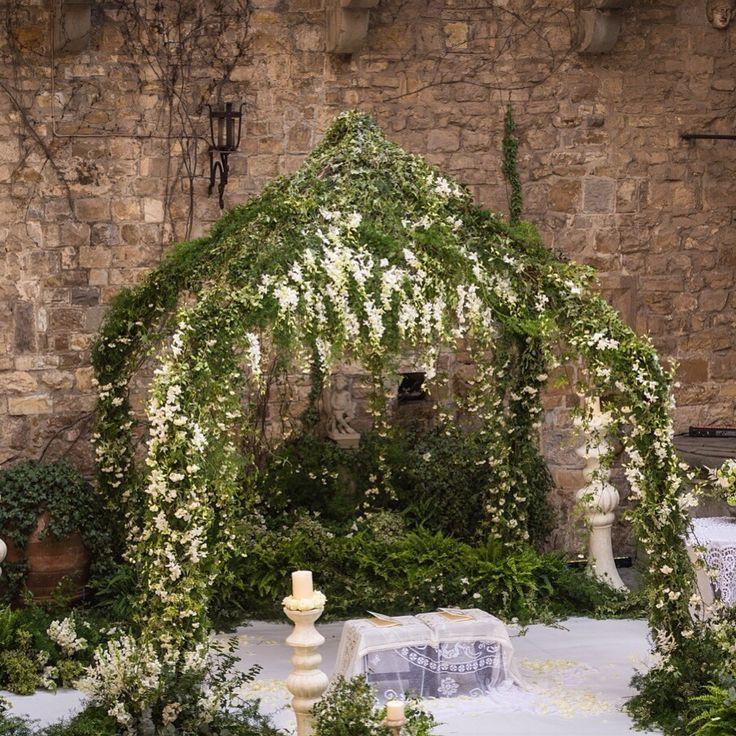Bucolic organic chuppah, greenery and white flowers, boules hanging