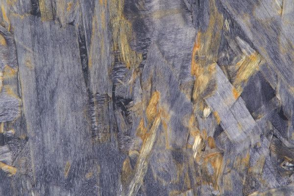 Made from Sustainable Forestry Initiative-certified recycled wood chips, TorZo's Orient board has a unique, abstract pattern. Depending on the environment Orient is used in, it can provide a sleek, modern look or a more rustic look. Using a proprietary infusion process at TorZo's Woodburn, Oregon factory, Orient is infused with acrylic polymer and dyes.