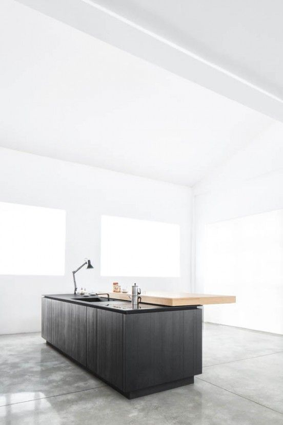concrete floors + white walls + light + black wood cabinetry + cantilevered bar