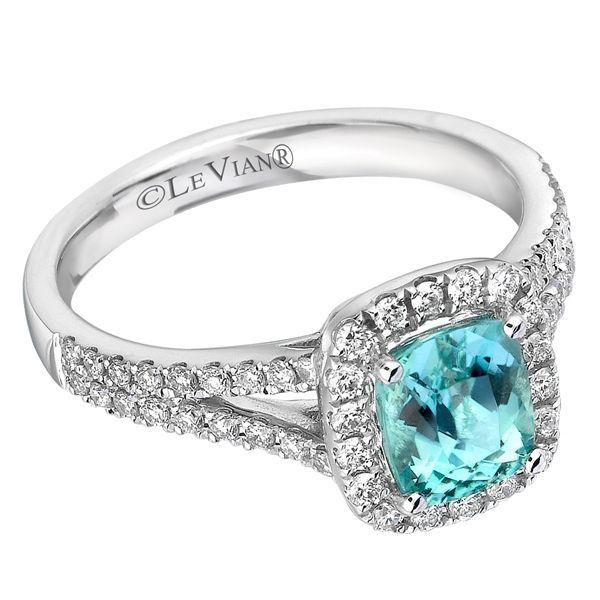 Cushion cut Paraiba Tourmaline center framed with .39 carats of Vanilla Diamonds set in 18K WG. Style # - MELI 573