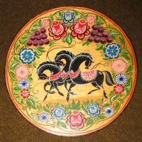 Gorodets painting (Городецкая роспись in Russian) is one of the folk arts and crafts of Russia, and a phenomenon of the so-called naive art. Gorodets painting sprang from carved Gorodets distaffs that were manufactured in villages nearby Gorodets town in the Nizhni Novgorod Region. Initially Gorodets craftsmen used the incrustation technique to ornament the distaffs. The mid 19th century saw the transition from incrustation to painting of Distaff....