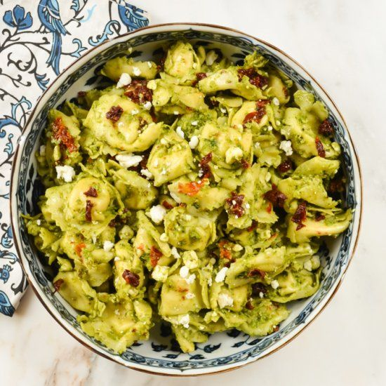 A cold tortellini salad filled with pesto, sun dried tomatoes and feta! A summer time must make!