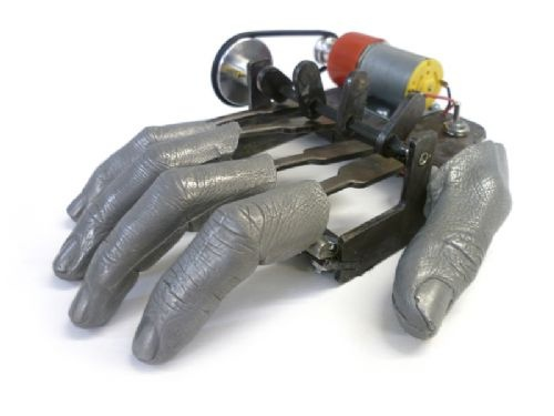 Fingers Mk II by Nik Ramage for Laikingland  An eternally tapping copy of the artist's own hand.  At the flick of a switch the resin cast fingers drum rhythmically until switched off.