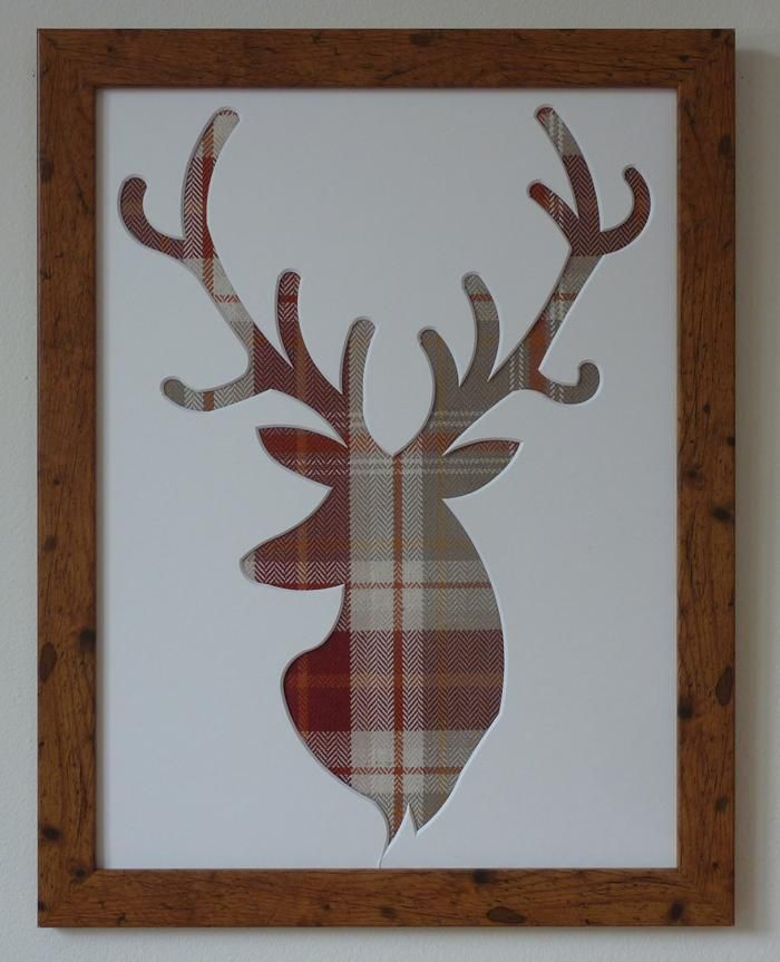 Stag's head picture frame - tartan fabric.  You could do a lion.