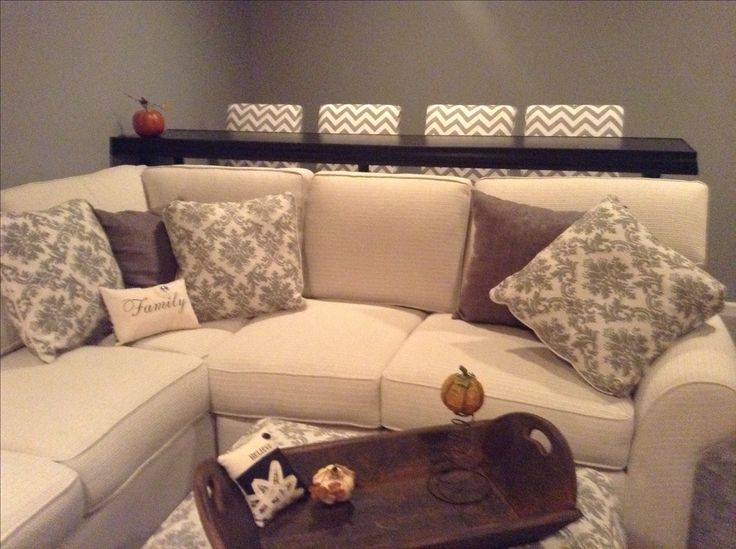 Best 25 bar behind couch ideas on pinterest bar table for Basement couch ideas