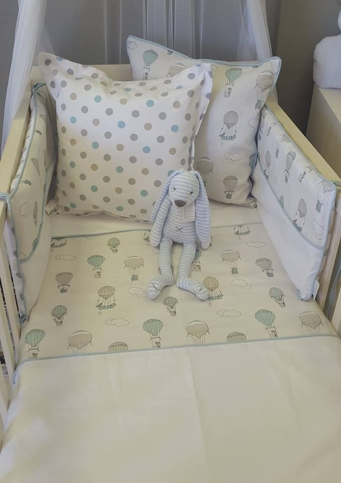 Cot duvet cover, cot bumper cover and a reversible scatter cushion fashioning our Up and Away, Blue fabric; which is printed especially, and exclusively, for Studio Collection. Our Reece Rabbit Blue, and a reverisble scatter cushion in our Bubbles, to wrap it all up