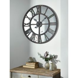 With a distressed verdigris metal frame and mirror backing, our unique clock will make a statement in your living space. The antique inspired design and verdigris metal finish lend an eclectic feel.