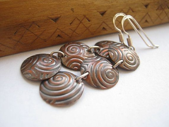"""Unique style, handmade dangle earrings out of spiral-patterned, domed copper discs and sterling silver wire and hooks. Total length: 2"""" (52 mms) / Vörösréz és ezüst fülbevaló"""