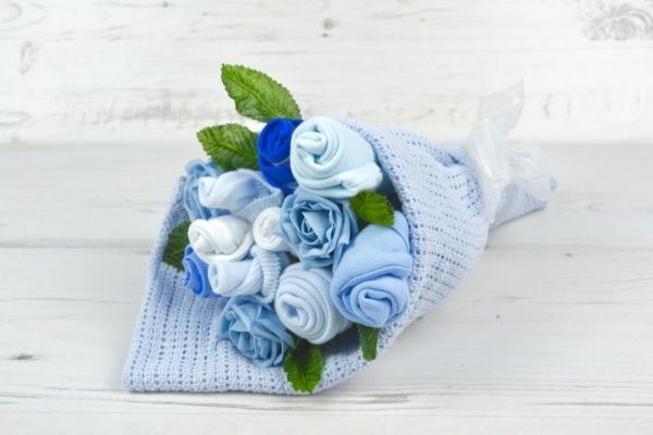 New Baby Bouquet - Blue  So much more than flowers! A practical gift that looks beautiful, can be displayed in the Hospital and consist of baby clothes and a blanket