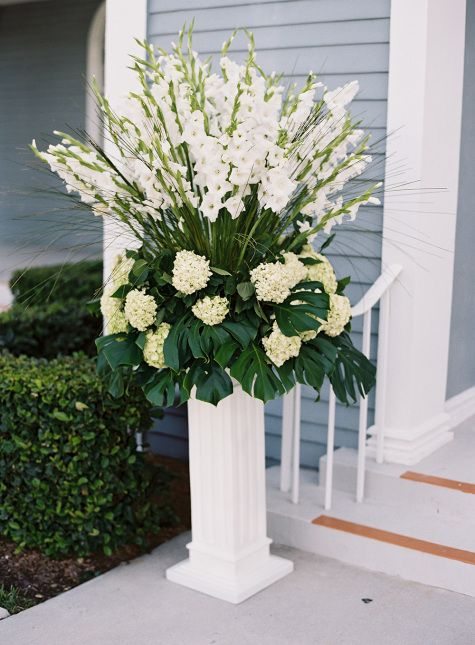 White ceremony flowers from a wedding at Royal Ponciana Chapel from Kat Braman Photography! More http://www.theknot.com/submit-your-wedding/photo/9b6f3941-990b-4acb-8a06-b02902211025/Dean-Wedding