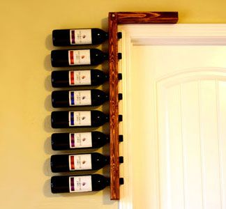 in love this idea. i want too make one that completely frames the door though, so the wine is on either side.