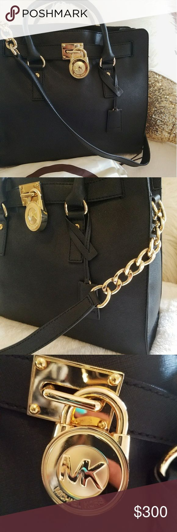 Authentic Michael Kors Hamilton Large Tote Large black hamilton tote. Gently used/ like new. Inside of bag is in excellent condition. Comes with dust bag and care card. Michael Kors Bags