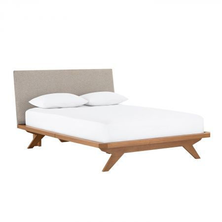 Bed frame with warm wood, angled feet on flat plane with bedend, thick frame and upholstered angled headboard - Domayne