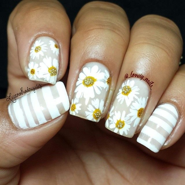Can you guess which Nailtini shade was used as the base of this beautiful manicure by @_lovely_nails_ on Instagram? #NailArt #Daisies