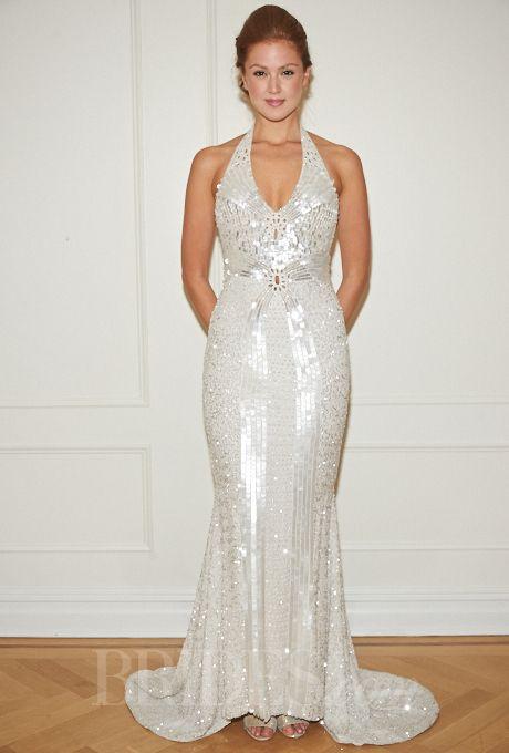 Brides.com: Randi Rahm - Fall 2014. Sleeveless beaded sheath wedding dress with v-neckline and halter straps, Randi Rahm