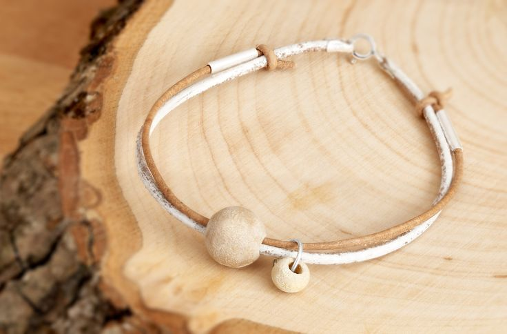 Personalized Leather Bracelet, Sterling Silver clasp and tube with Wooden Beads from the same year when you and your loved ones were born. by MsHeartwoodJewellery on Etsy  Photos by: http://www.silverlightstudio.co.uk/