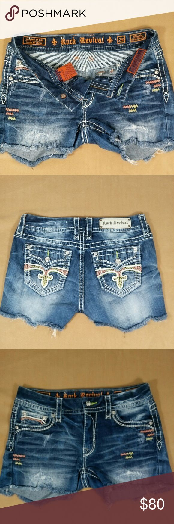 """Rock Revival jean shorts size 29 Winnie Easy Medium wash distressed with pastel color stitched design on back pockets and front detail. Size 29 Rise 8 1/2 Hips 18"""" side to side Rock Revival Shorts Jean Shorts"""