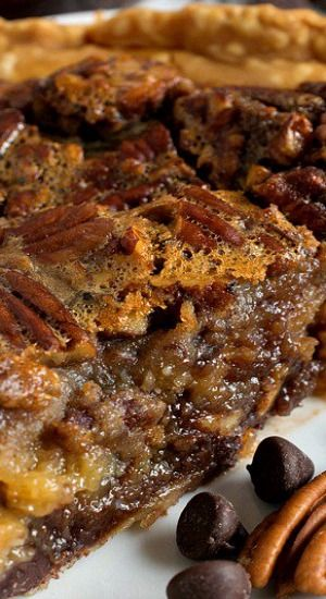 This Chocolate Bourbon Pecan Pie takes a classic dessert – pecan pie – then kicks it up a few notches with the addition of chocolate chips and Bourbon to the filling!