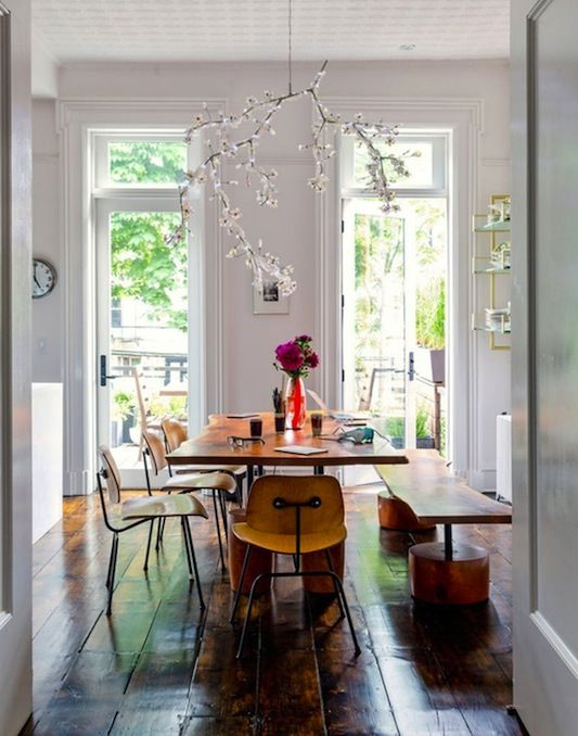 Beautiful light in this dining room. Love the hanging branch of blossom.
