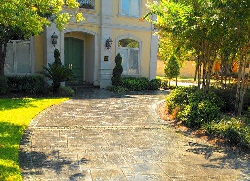 Stamped concrete driveways are a great way to compliment trendy landscaping / Titan Concrete. Plano, TX