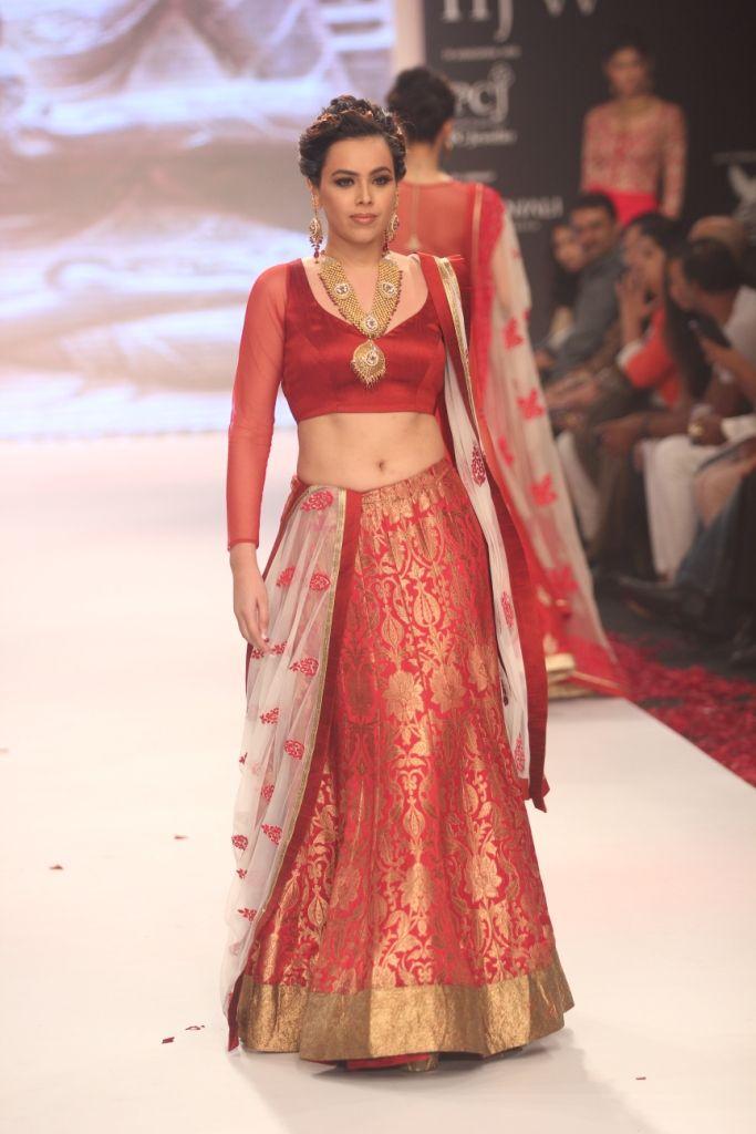 A gorgeous red bridal lehenga <3